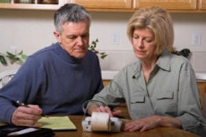couple checking bills